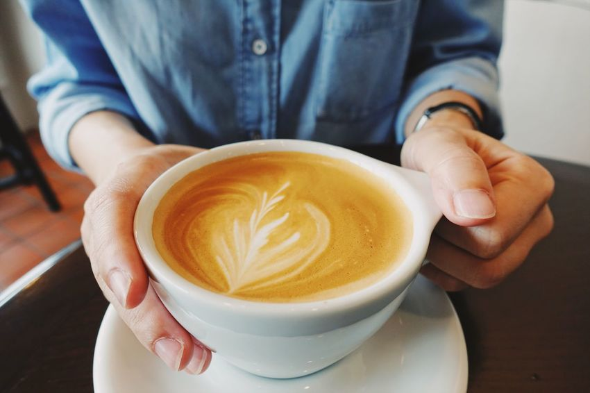 Coffee - Drink Coffee Cup Drink Real People Refreshment One Person Lifestyles Human Hand Cappuccino Food And Drink Froth Art Close-up Frothy Drink Holding Indoors  Human Body Part Latte Freshness Cafe Coffee Break Latteart Bangkok Thailand. Cafehopping Hot Drink Morning