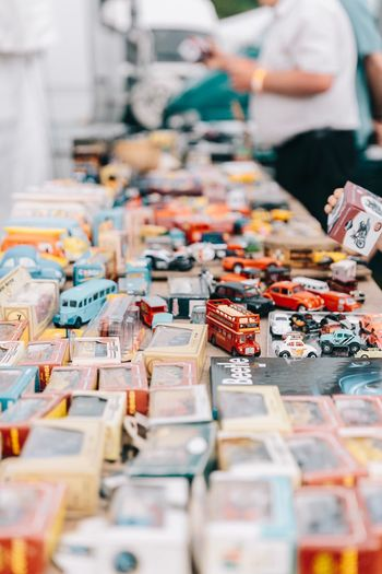 Toys Collectors Item Collections Close-up For Sale Large Group Of Objects Selective Focus Market Stall Sale Abundance Outside Car Vehicle Toy Car Bright Depth Of Field Colors Colours Bus