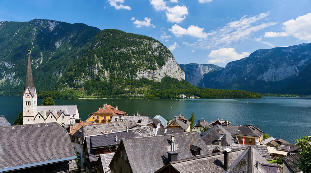 Hallstatt, picturesque village in Austria Alps Austria Ancient Architecture Austria Beauty In Nature Church Cloud - Sky Famous Place Hallstatt, Austria Idyllic Lake Landmark Landscape Muntain Nature Outdoors Picturesque Village Resort Rooftops Salzkammergut, Austria Scenery Summer Sunny Day Tower UNESCO World Heritage Site Village