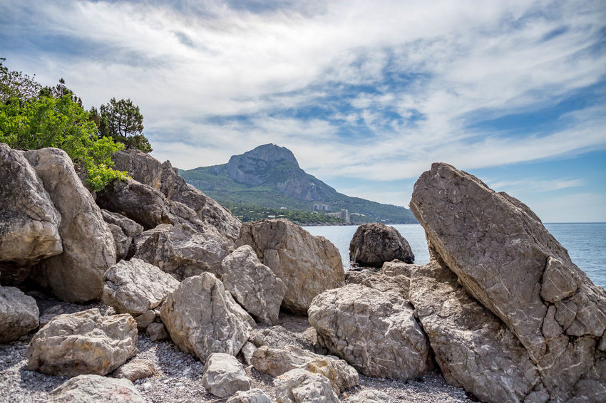 Beauty In Nature Cloud - Sky Day Environment Formation Idyllic Mountain Mountain Peak Nature No People Non-urban Scene Outdoors Rock Rock - Object Rock Formation Scenics - Nature Sea Sky Solid Tranquil Scene Tranquility Water