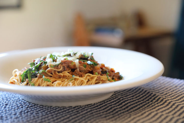 Spaghetti Bolognese Bolognese Spaghetti Food And Drink Table Food Indoors  Still Life Freshness Close-up Ready-to-eat Focus On Foreground Selective Focus Wellbeing Plate Serving Size Healthy Eating Pasta Italian Food Meal Indulgence Garnish Dinner Crockery