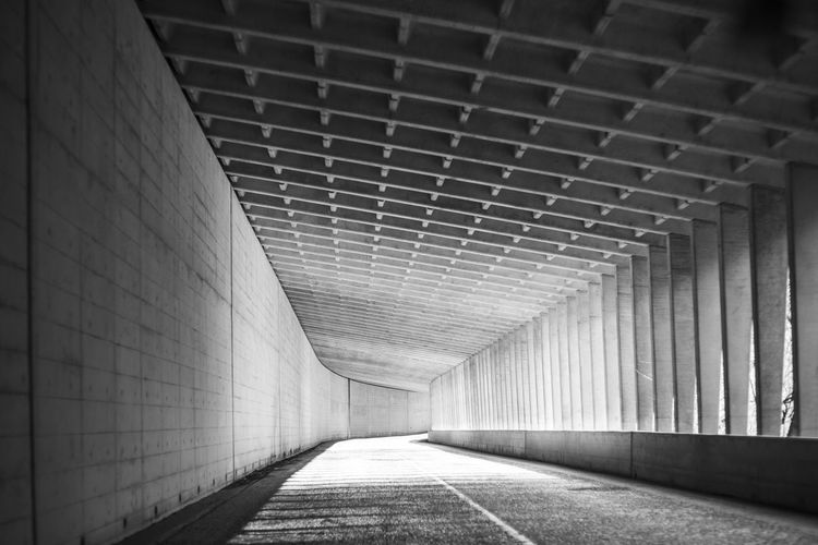 A geometrically interesting tunnel in the mountains of Japan. Architecture Japan Road Architectural Column Architecture Black And White Built Structure Ceiling Diminishing Perspective Direction Empty Geometry Pattern Light At The End Of The Tunnel Long No People Pattern Streetphotography Subway The Way Forward Transportation Tunnel Underground Walkway Underpass Wall Wall - Building Feature