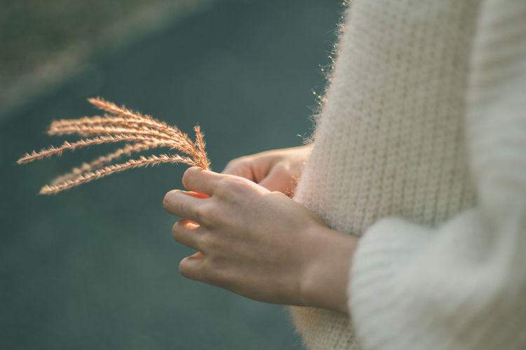 Close-up of woman holding hands during winter