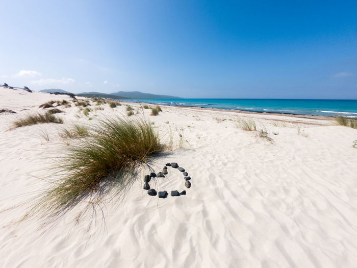 sardinia beach of porto Pino with love symbol Land Sky Sand Sea Water Nature Beach Scenics - Nature Tranquility Day Horizon Tranquil Scene Beauty In Nature No People Landscape Horizon Over Water Environment Travel Blue Travel Destinations Outdoors