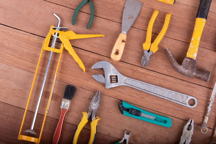 High angle view of tools on wooden floor