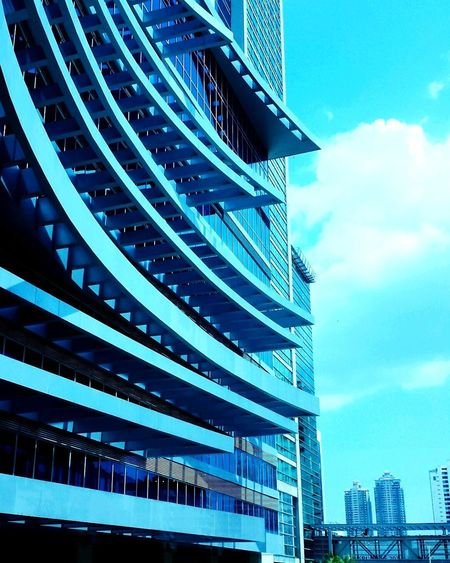 EyeEmNewHere Architecture Modern Built Structure Building Exterior Sky Blue City Cloud - Sky Outdoors Skyscraper Futuristic No People Day Urban Skyline Cityscape PanamaCity Blue Building Blue Building Blue Sky