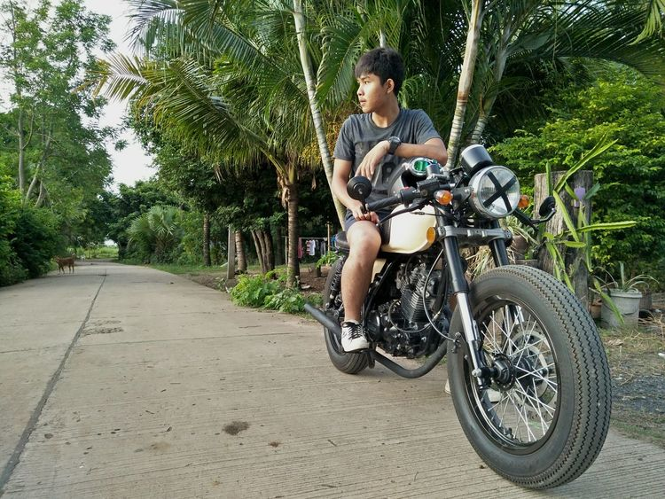 One Person Transportation Riding One Man Only Only Men Leisure Activity Day Bicycle One Young Man Only Motorcycle Outdoors Adults Only Full Length Tree People Sport Men Lifestyles Adventure Adult