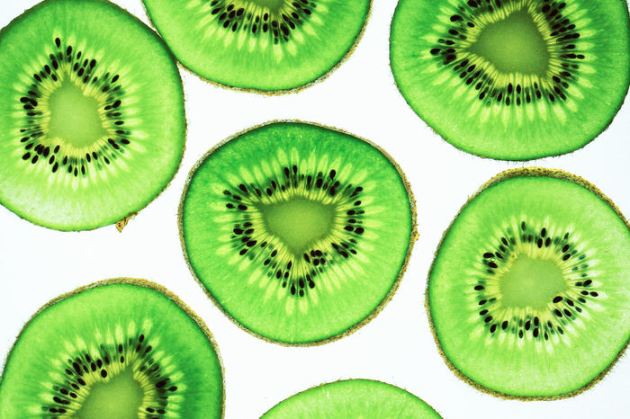 Still life picture, Abstract fruit background is close up on Kiwi sliced, to show a detail on fresh kiwi face with white background Advertising Diet Eating Isolated Natural Natural Beauty Retro Backgrounds Close-up Creative Day Food Full Frame Green Color Healthy Indoors  Juicy Kitchen Kiwi No People Pattern Sections Slices Variation White Background