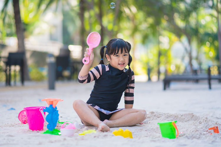 Portrait of cute boy playing with toy