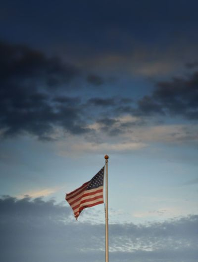 View Of American Flag Against Cloudy Sky