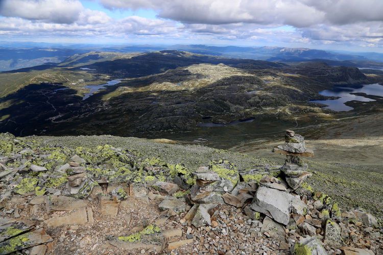 Hiking on Gaustatoppen. The view from Gaustatoppen mountain in Telemark, Norway. Beauty In Nature Cloud - Sky Day Growth Landscape Nature No People Outdoors Scenics Sea Sky Water Gaustatoppen Rays Of Sunshine Wilderness Area Rocks Tranquil Scene Norwegian Landscape Norwegen Norwegian Gaustatoppen, Norway Norway Travel Destinations Rays Of Light Mountain