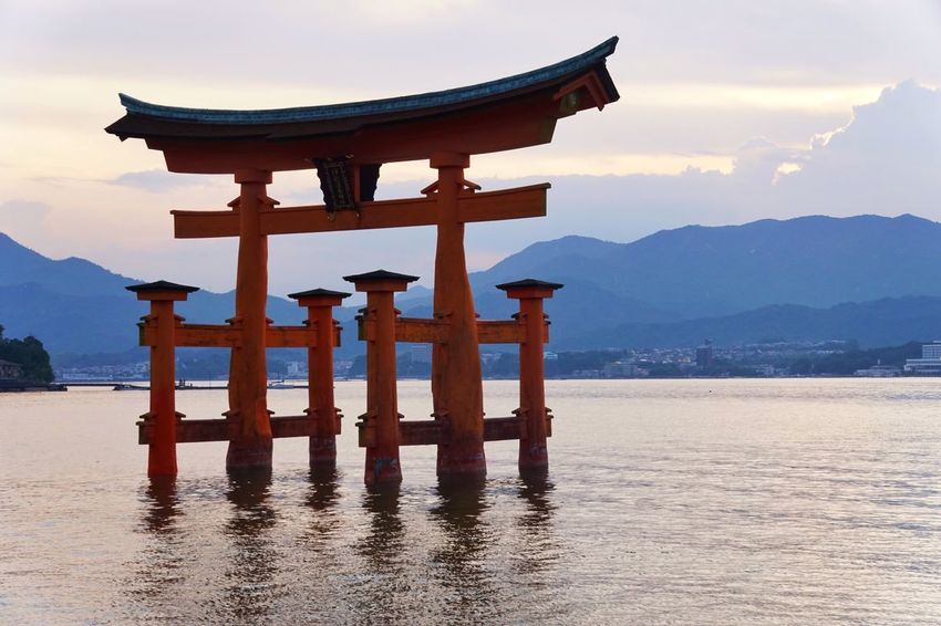 Buddhism Torii Gate TORII Tori Mountain Religion Scenics Spirituality Travel Destinations Nature Water Tranquil Scene Sky Beauty In Nature Tranquility Place Of Worship Sea Wood - Material