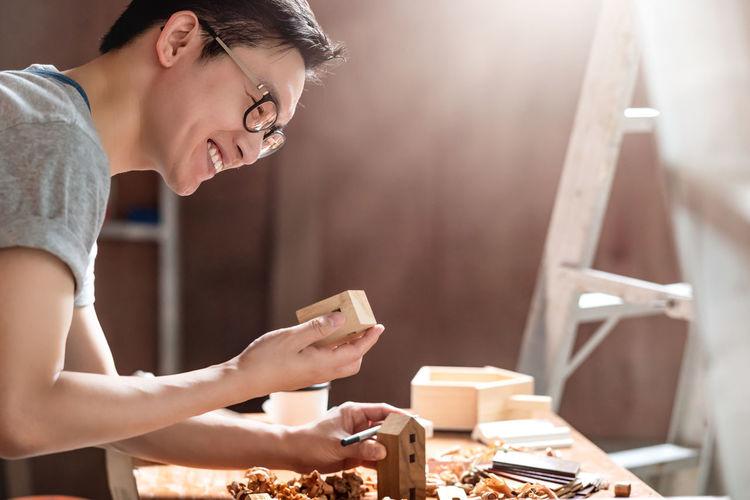 Close-up of carpenter working in workshop