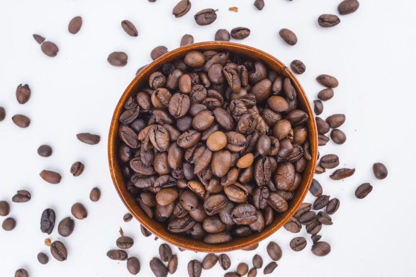 Roasted coffee beans and hot coffee with isolated white background Agriculture Caffeine Coffee Isolated Nature Raw Arabic Aroma Background Bean Brown Cafe Drink Energy Flavor Food Fresh Fruit Gourmet Harvest Organic Roasted Roasted Coffee Bean Sky Taste