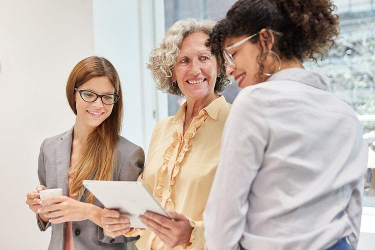 Businesswomen working over digital tablet in office