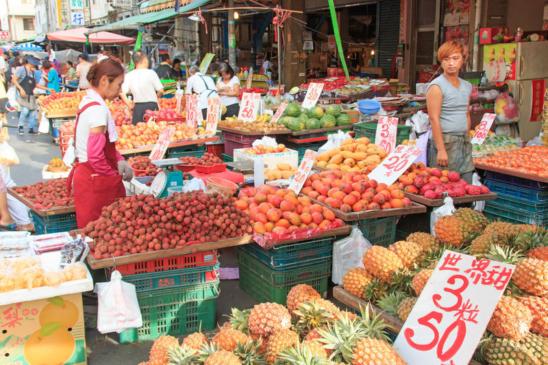 Kaohsiung, Taiwan - June 22,2015: People selling and buying food in a traditional fruit and vegetable market of Taiwan Abundance Choice Collection Display Food For Sale Freshness Fruit Large Group Of Objects Market Market Market Stall Price Tag Retail  Sale Shop Shopping Small Business Store Street Market Taiwan Taiwan Food Taiwanese Variation Vegetables