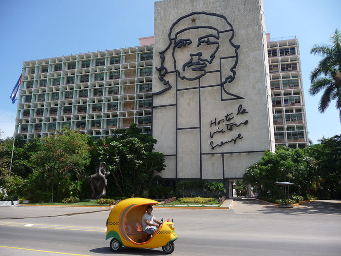 Ministry of the Interior in La Plaza de la Revolution with Coco taxi, Havana Architecture Building Exterior Che Guevara Che Guevara Memorial City Coco Taxi Cuba Day Havana Helmet Outdoors Real People Road Street Taxi Tourism TukTuk