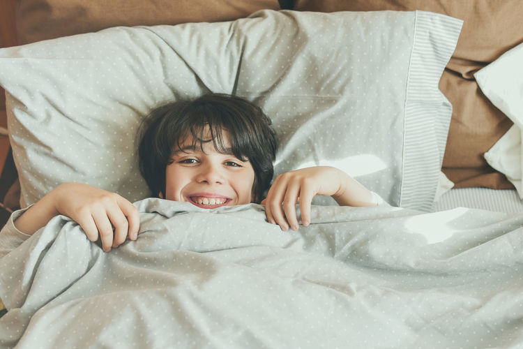 Childhood Child Portrait Bed Looking At Camera Cute Lying Down Innocence Relaxation Happiness Wake Up Morning Bed Bedroom Energy Lifestyle Up Laziness Home Sleep Sleepyhead Happy Smile Stretch Stretching Yawn Pillow Blanket Resting Resting Time Lying Pajamas People Healthy Healthy Lifestyle Kid