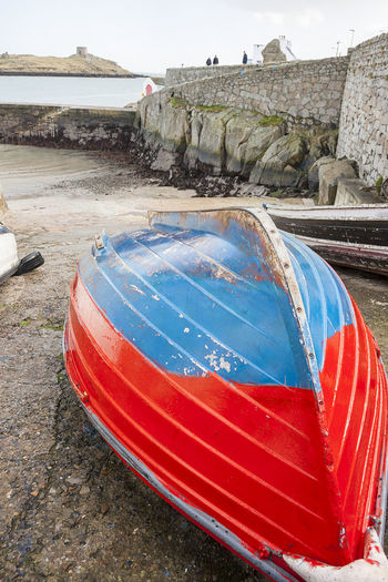 Colorful boat docked in Dalkey Water Nature Architecture Day Nautical Vessel No People Built Structure Beach Land Transportation Outdoors Mode Of Transportation Sky Red Blue Travel Destinations Building Exterior Inflatable  Sea Boat