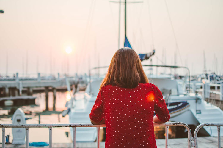Light Marina Sunlight Twilight Boat Day Focus On Foreground Harbor Leisure Activity Marina Bay Moored Nature Nautical Vessel One Person Outdoors People Real People Rear View Sailboat Sea Sky Standing Sun Sunlight And Shadow Sunset Transportation Travel Destinations Vacations Water Women Yacht Young Adult