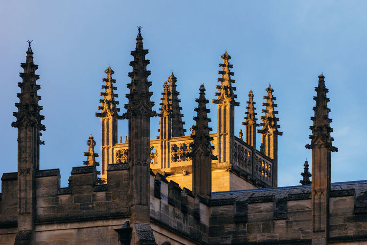 Dreaming Spires Architecture Architecture_collection Oxford Oxford University Roof Rooftop Spires Arch Architectural Column Architectural Detail Architectural Feature Architecture Building Exterior Built Structure Clear Sky Day Low Angle View No People Outdoors Place Of Worship Religion Sky Spire  Spirituality Vertical