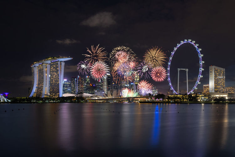 Singapore National Day 2018 Fireworks celebrating its independence 2018 ASIA Beautiful Celebration Downtown Marina Bay Sands National Day Singapore Anniversary Architecture Arts Culture And Entertainment City Colorful Exploding Ferris Wheel Firework Firework Display Illuminated Light Long Exposure Marina Bay Nation Night Skyscraper Waterfront