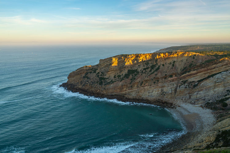 Sea cliffs landscape in cabo espichel at sunset, in portugal