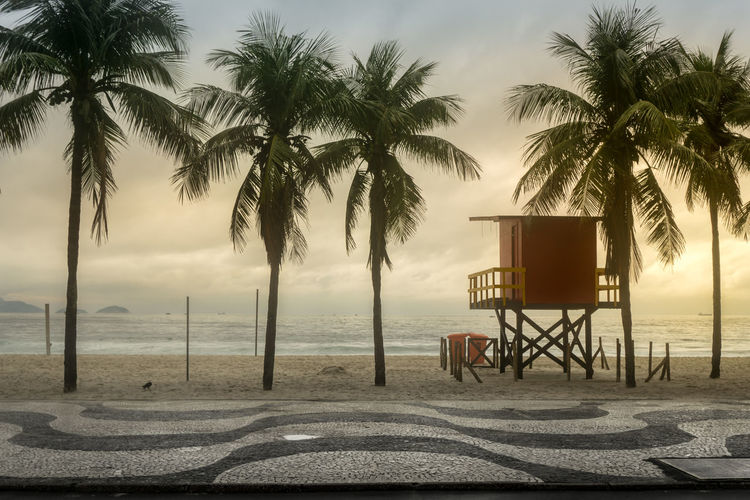 Beach Beauty In Nature Chair Cloud - Sky Day Horizon Over Water Lifeguard Hut Nature No People Outdoors Palm Tree Scenics Sea Sky Sunset Tranquil Scene Tranquility Tree Water