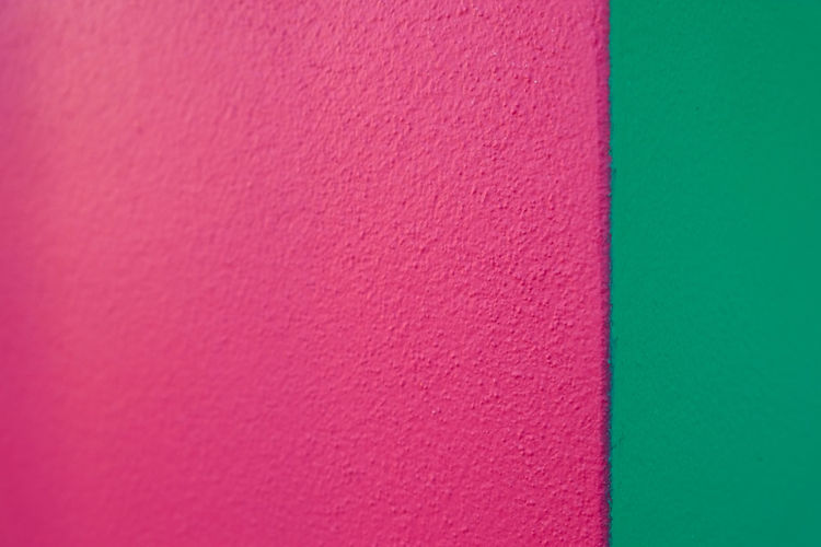 Abstract geometric pattern on concrete wall Art And Craft Backgrounds Blank Built Structure Close-up Copy Space Craft Creativity Full Frame Green Color Indoors  Material Multi Colored No People Pattern Pink Color Red Studio Shot Textile Textured  Wall - Building Feature