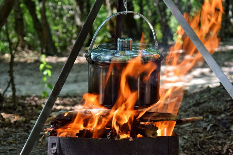 Close-Up Of Food Cooking On Camping Stove