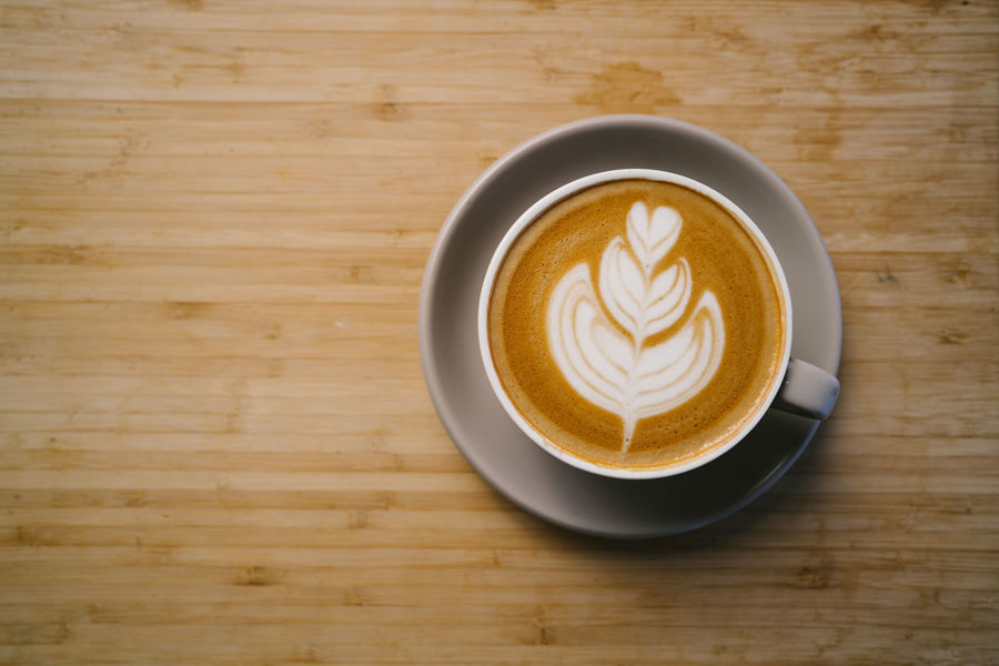 Latte art Coffee - Drink Coffee Refreshment Food And Drink Coffee Cup Drink Cup Mug Frothy Drink Still Life Hot Drink Froth Art Table Wood - Material Freshness Indoors  Saucer Crockery Cappuccino Directly Above Latte No People Non-alcoholic Beverage Wood Grain
