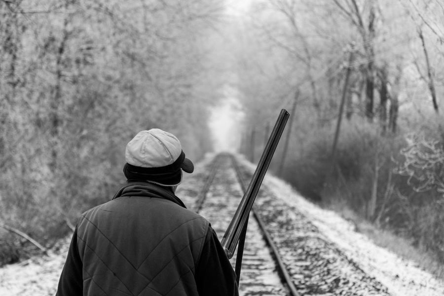 Black And White Cap Cold Flat Cap Forest Gun Hunt Hunter Hunting Men Nature Nature Only Men Outdoors Rail Real People Snow Warm Clothing Winter Welcome To Black Lost In The Landscape