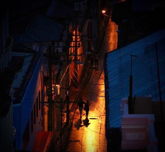 People on illuminated city at night