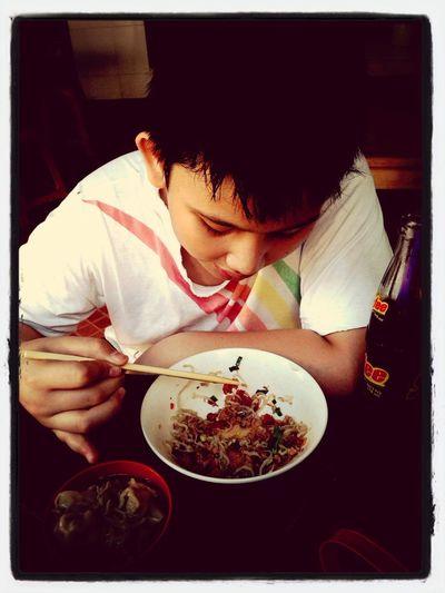 Enjoying a bowl of noodles (Bakhmi Siantar) with my nephew Enjoying Life