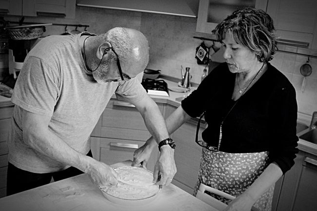 Italian do it better 🍰 Senior Adult Senior Women Senior Men Two People Domestic Kitchen Domestic Life Mature Adult Kitchen Retirement Indoors  Real People Lifestyles Senior Couple Adult Women Food Commercial Kitchen People Mixing Teamwork