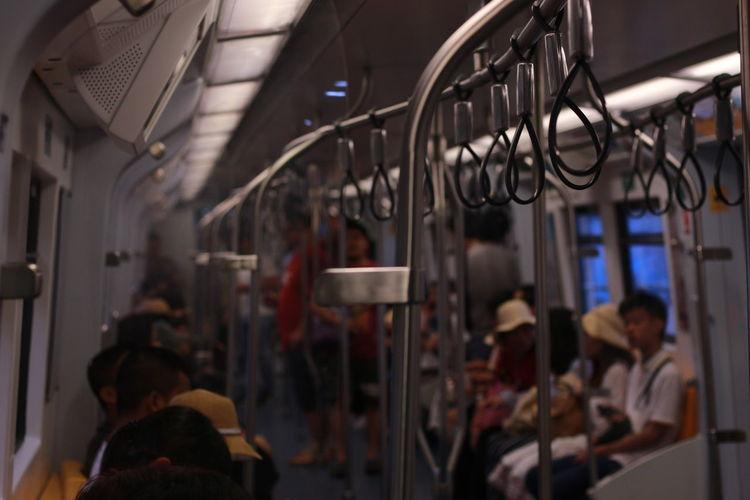 Group of people in metro train