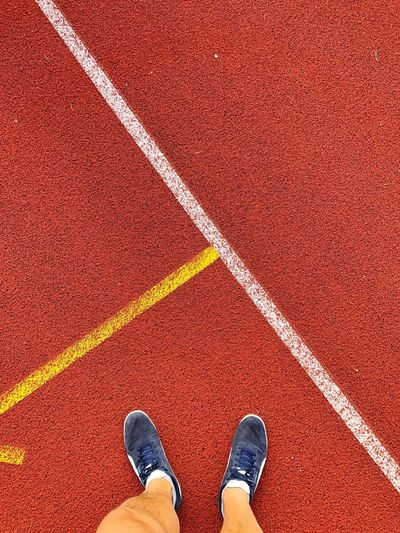 Motivated Fitnessmotivation Sport Training Fitness Sports Running Run Low Section Body Part Human Body Part Human Leg One Person Personal Perspective Track And Field High Angle View Day Running Track Real People Lifestyles Shoe Directly Above Human Limb Sport Standing Red Men Outdoors