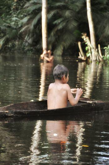 Relaxing Enjoying Life Indigenous  People Photography Colombia Eyeemphotography EyeEm Nature Lover Nature Photography Lostplaces EyeEm Best Shots - People + Portrait Amazon Kidsphotography Indigenous Boy Kidslife