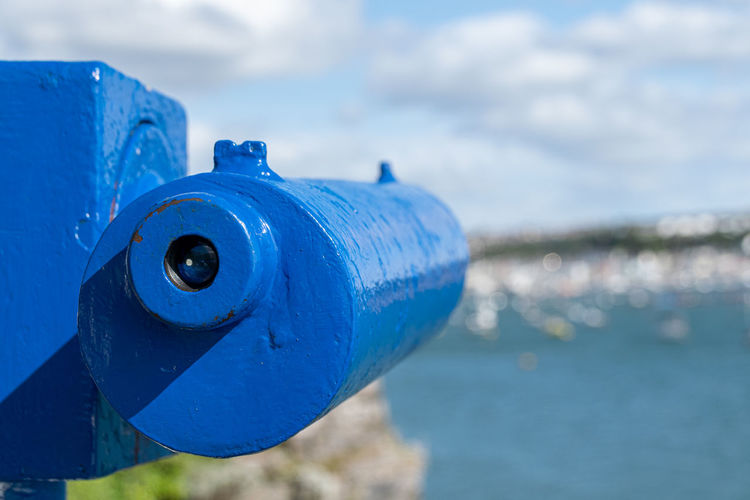 Coin operated binoculars or telescope looking over a coastal harbour