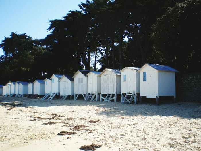 Beach Sand cabines de plage wooden Beach Cabins Plage Des Dames Plage Du Bois De La Chaise beach huts Beauty In Naturetrees Noirmoutier Island Beach Vendée France No People Tranquil Scene