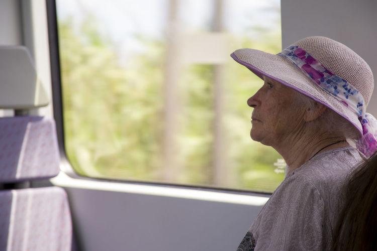 Senior woman traveling in train