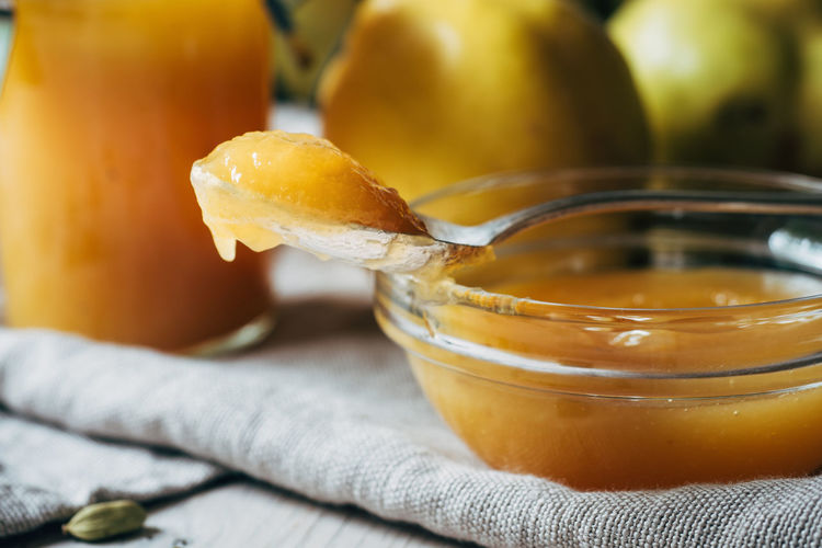 Close-up of quince preserves in bowl on table
