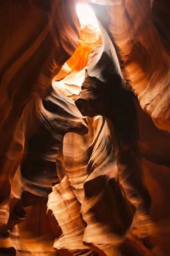 Beautiful vibrant colors of Upper Antelope Canyon, the famous slot canyon in Navajo land in the American Southwest near Page, Arizona, USA American Arizona Natural Orange Rock Slot Sunlight Sunrays USA America Antelope Canyon Arid Canyon Cave Colorful Formations Geology Nature Nobody Outdoors Page Sandstone Travel Upper Vibrant