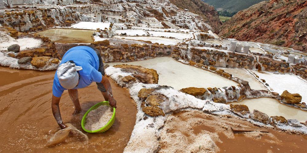 Man working at salt pans of maras