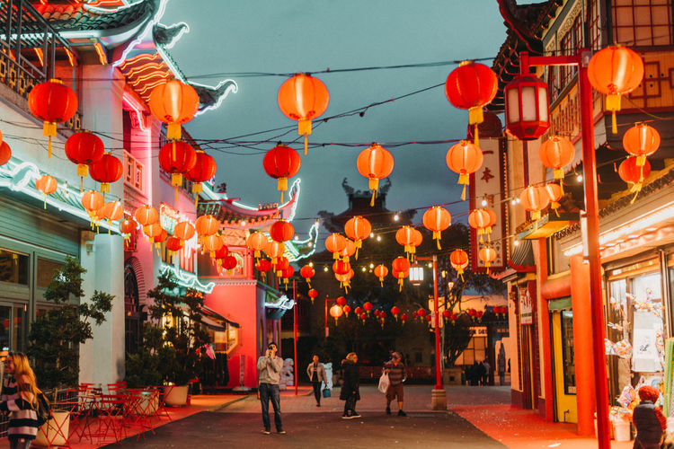 Architecture Building Exterior Built Structure Celebration Chinese Lantern Chinese Lantern Festival Chinese New Year City Decoration Festival Group Of People Hanging Illuminated Lantern Lighting Equipment Men Outdoors Paper Lantern Real People Red Street