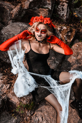 Closeup portrait of calavera catrina. young woman with sugar skull makeup and white spiderweb. dia