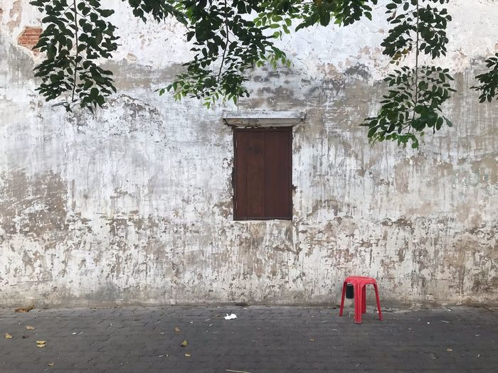 Red stool and a window Thailand No People Minimalism Red Stool Window Built Structure Architecture Building Exterior Day Building Wall - Building Feature Outdoors House Tree Lifestyles The Minimalist - 2019 EyeEm Awards