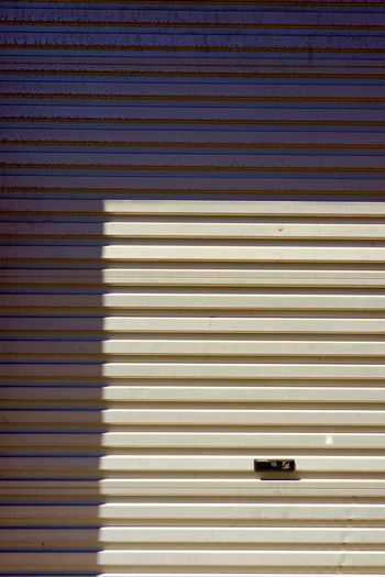 Architecture Built Structure Close-up Corrugated Iron Day No People Outdoors Pattern Shadow Shutter Striped Textured
