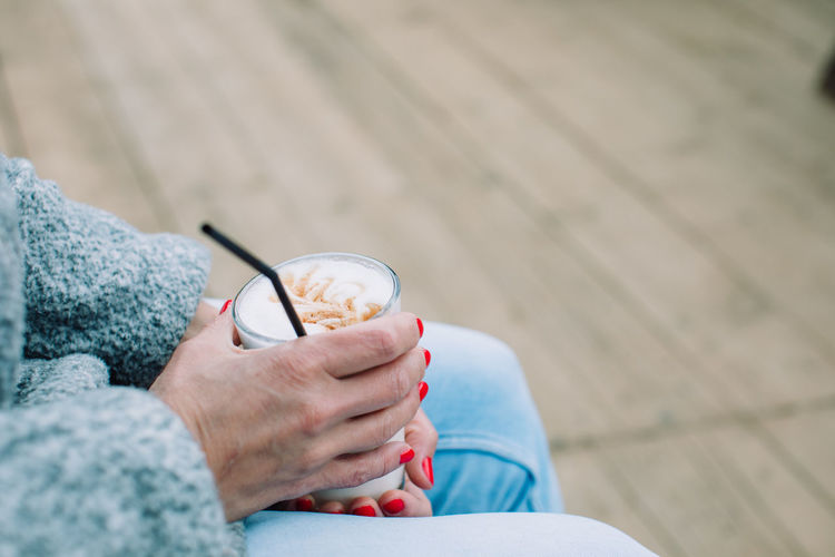 Low section of woman holding ice cream