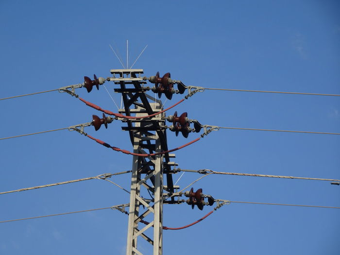 Blue Cable Clear Sky Communication Complexity Connection Day Electrical Equipment Electricity  Electricity Pylon Fuel And Power Generation Lighting Equipment Low Angle View Nature No People Outdoors Pole Power Line  Power Supply Sky Sunlight Technology Telephone Line